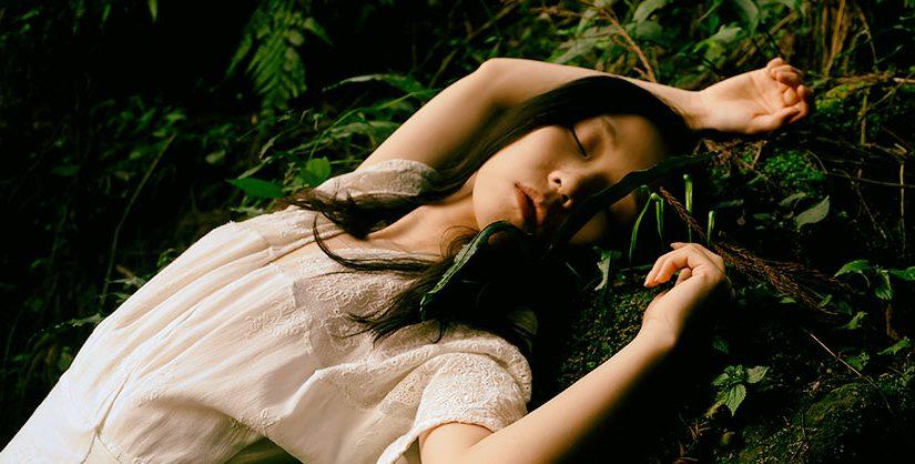 girl swooning in foliage | apollopad, free novel writing tool